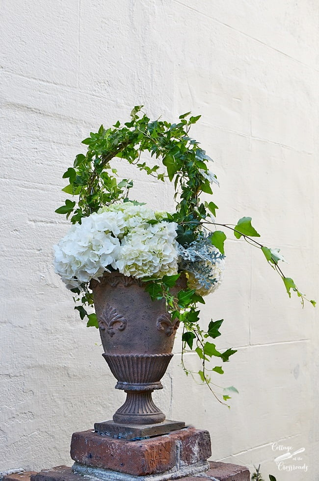 hydrangea arrangement in an urn