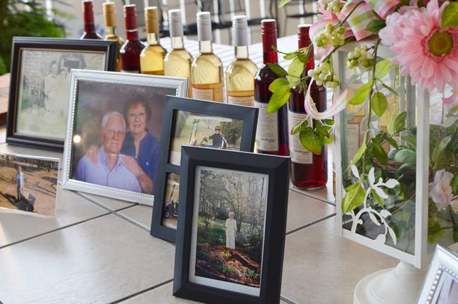 photos on display at a golf benefit party