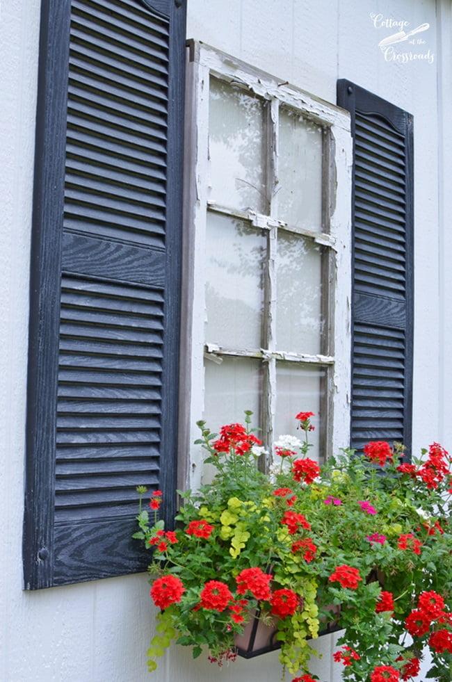 window box underneath a fake window on a building