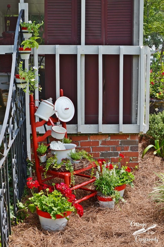 enamelware chair fountain   Cottage at the Crossroads