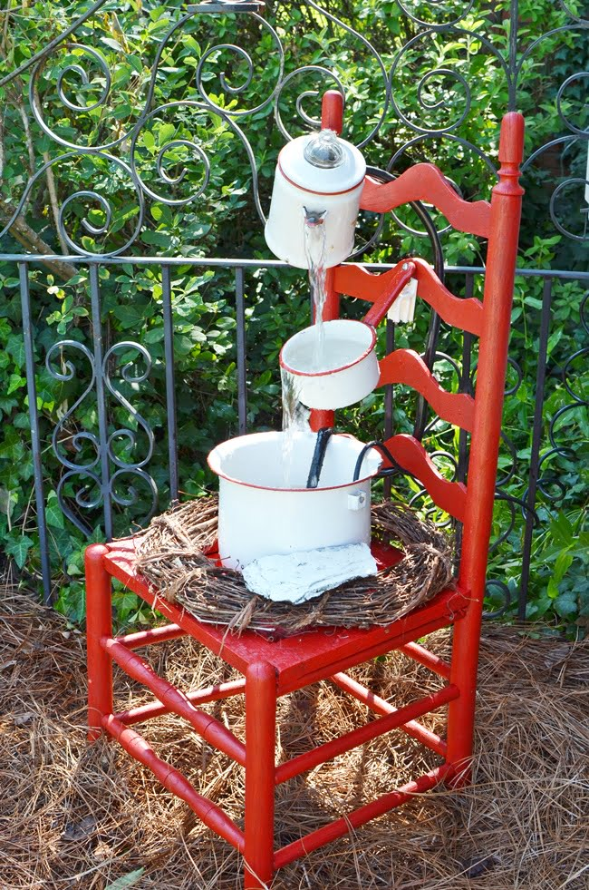 red and white vintage enamelware chair fountain