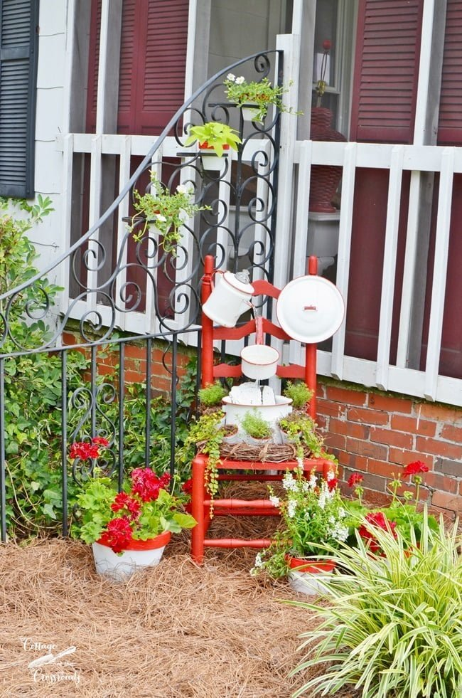 red and white enamelware chair fountain from Cottage at the Crossroads
