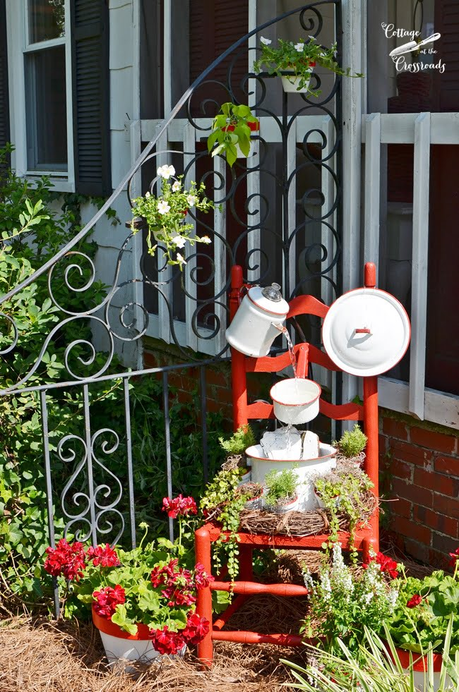 vintage red and white enamelware chair fountain from Cottage at the Crossroads