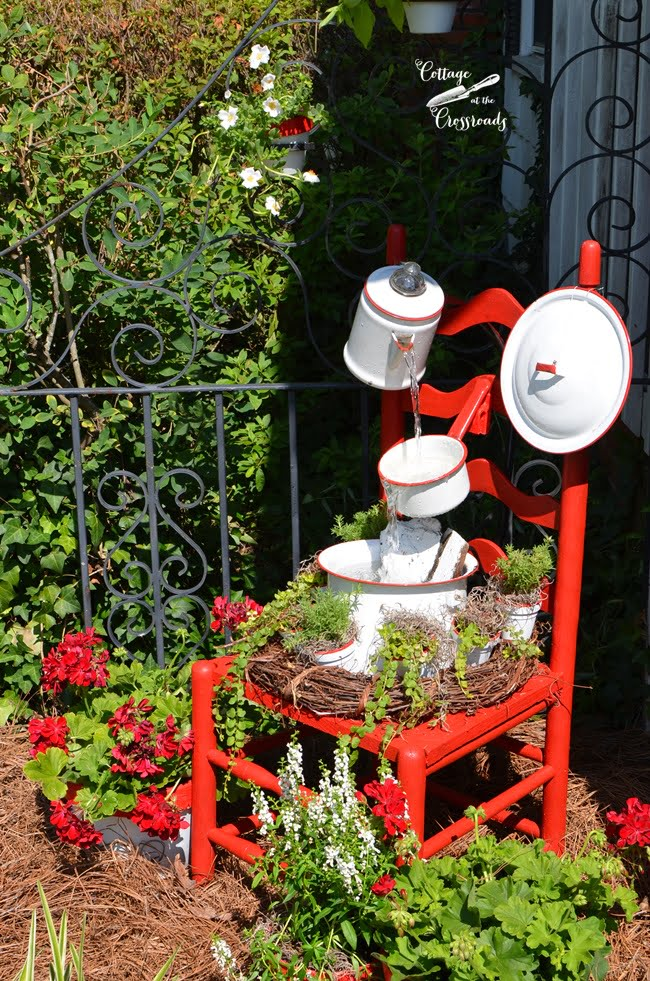 vintage red and white enamelware chair fountain