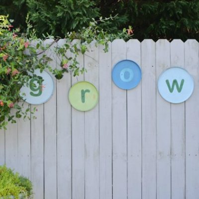 DIY garden GROW sign made from burner covers