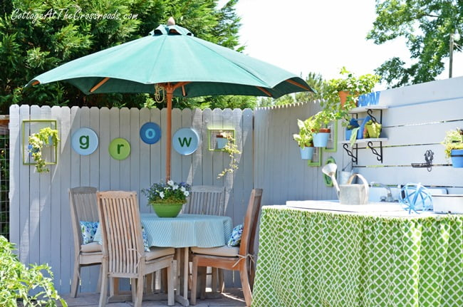 Grow letters on a wooden fence in a garden