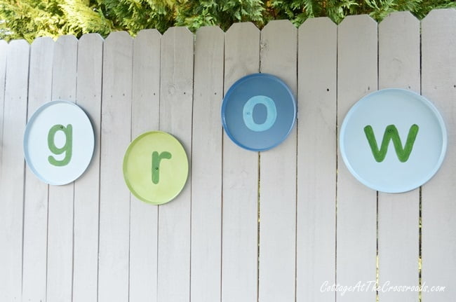 DIY GROW letters on a wooden fence