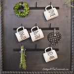 farmhouse style mug rack made from a thread rack