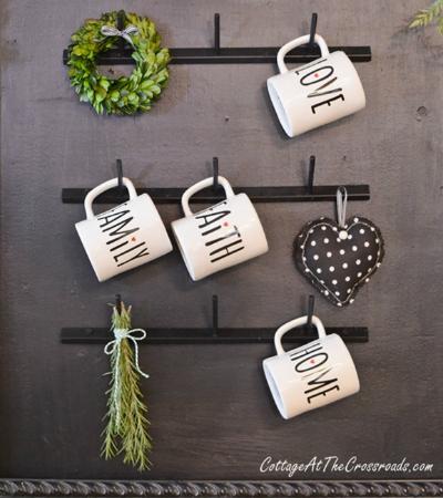 farmhouse style mug rack made from a thread rack
