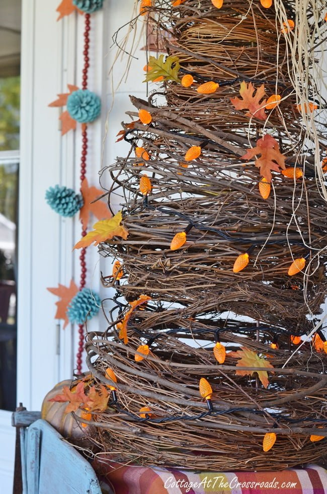 handmade grapevine tree used in decorating an autumn front porch
