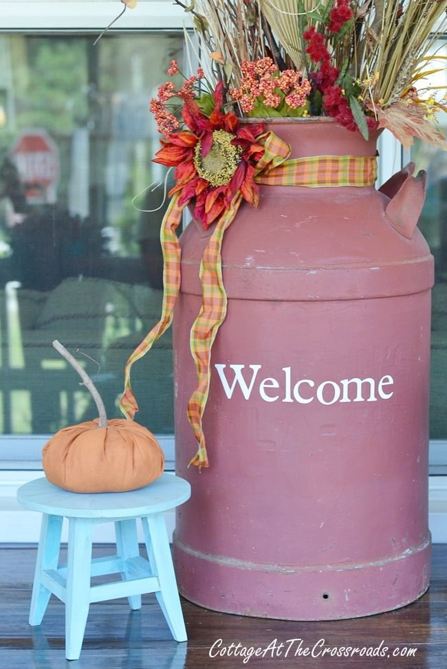 old milk can dressed for autumn