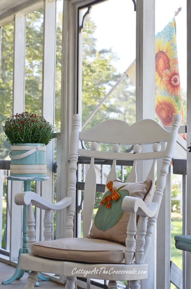 rocking chair on a fall front porch