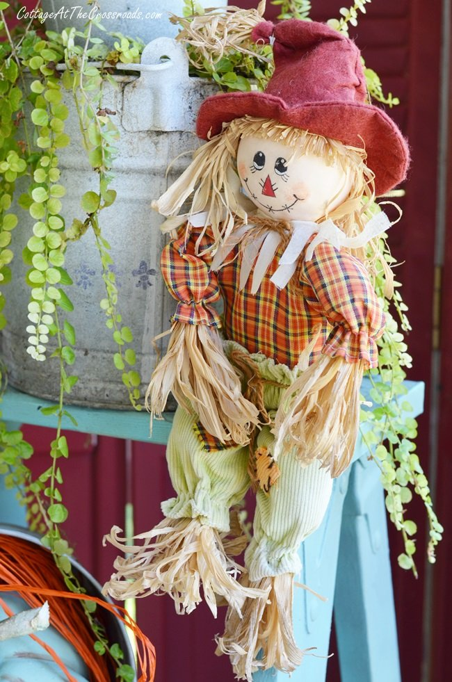 scarecrow on a fall front porch