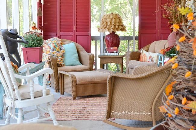 An aqua autumn porch sitting area