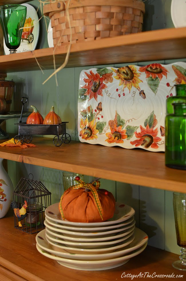 an autumn decorated farmhouse cupboard