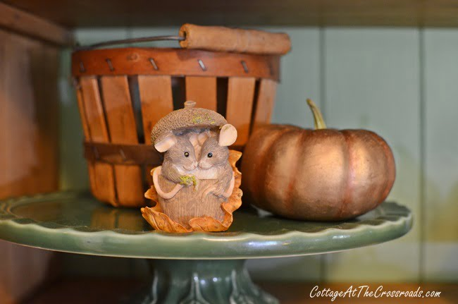 mice figurine on an autumn cupboard