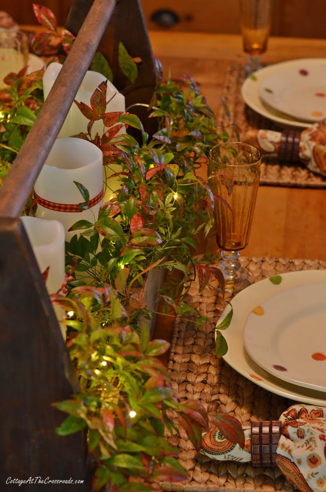 a traditional fall farmhouse tablescape celebrating the beautiful colors of the harvest season
