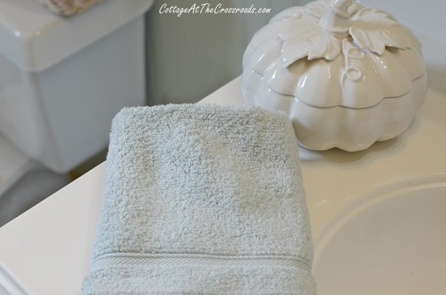 white ceramic pumpkin used in a fall bathroom update