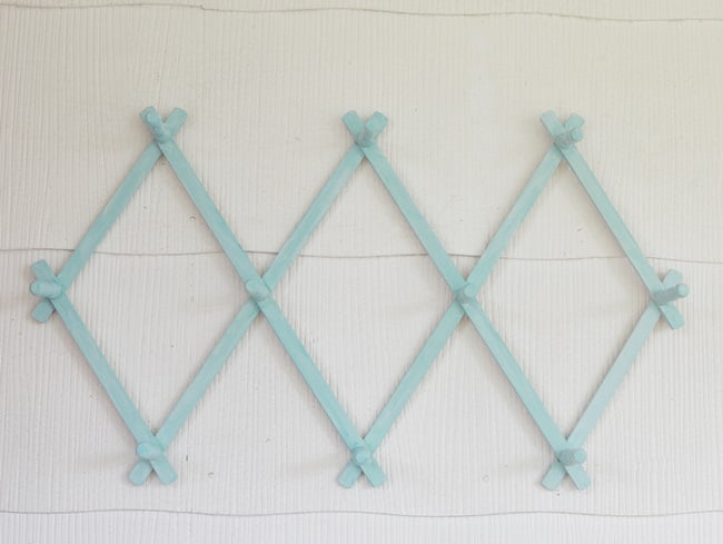 vintage accordion peg rack painted aqua blue