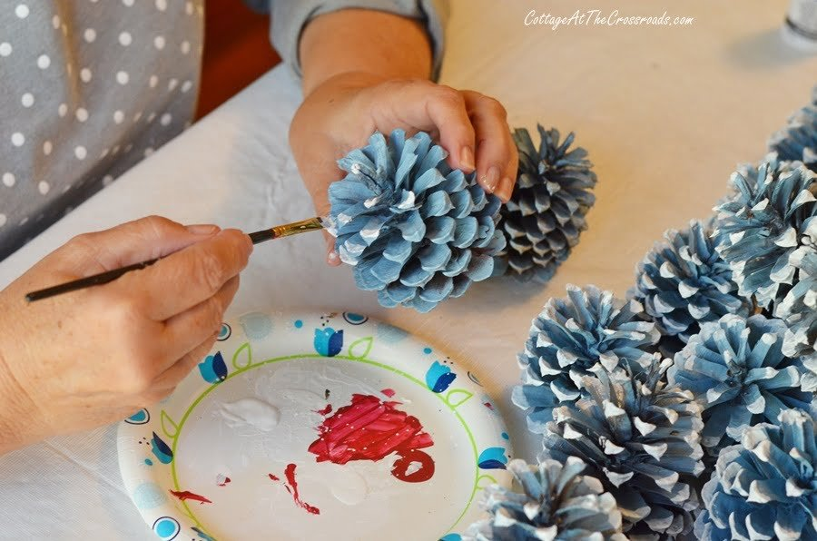painting the tips of pine cones