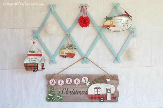 vintage camper ornaments hanging on a vintage wooden rack