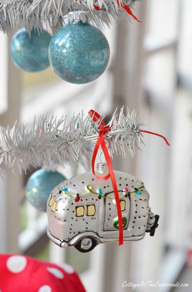 vintage camper christmas ornament on a camping themed porch