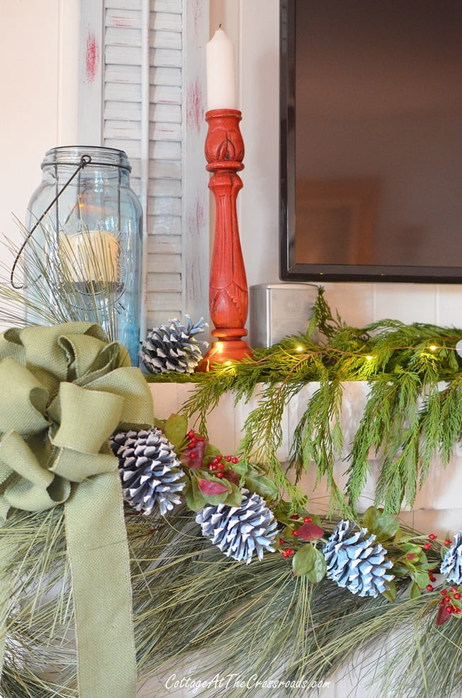 traditional Christmas mantel with painted pine cones