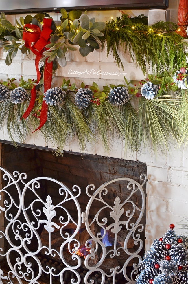 wispy faux pine garland used on a traditional Christmas mantel