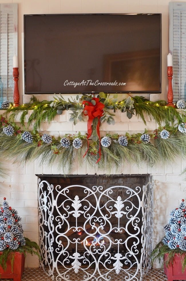 Christmas mantel with pine cone trees
