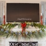 Traditional Christmas mantel with painted pine cone trees