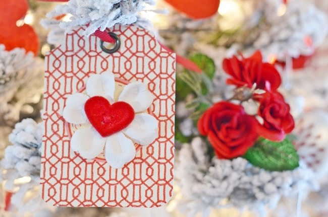 paper tag with a heart shaped button