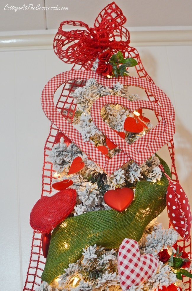 gingham fabric covered wooden hearts used as a tree topper