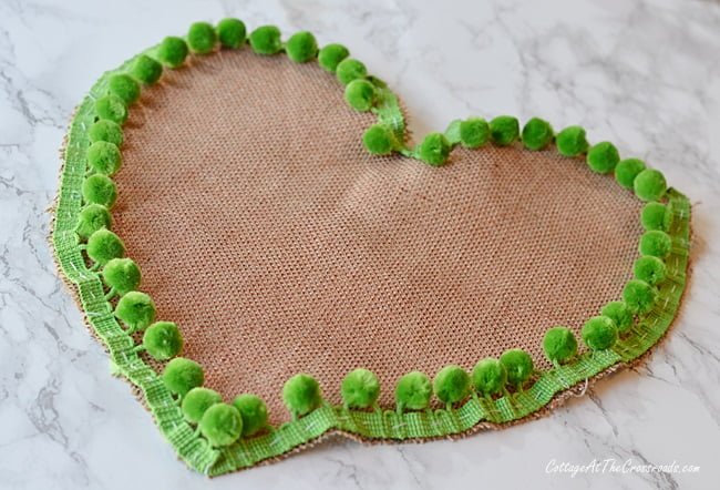 how to make a heart shaped pillow with pom pom trim