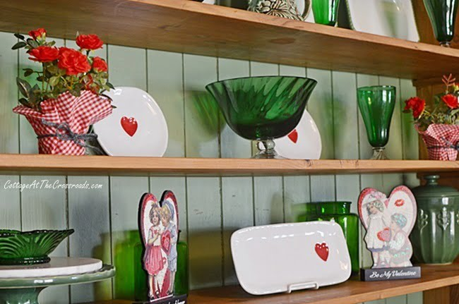 Valentine's Day decorations in a pine cupboard