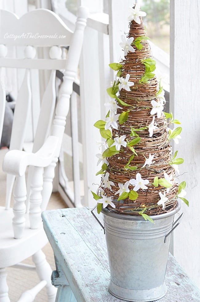 faux florals on an early spring grapevine cone