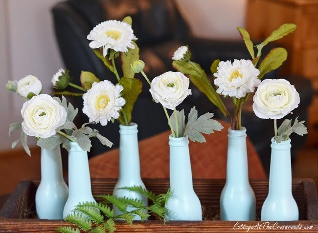early spring centerpiece using painted beer bottles