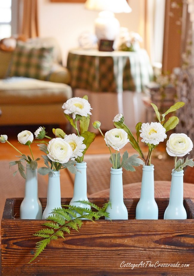 aqua bottles with faux white flowers