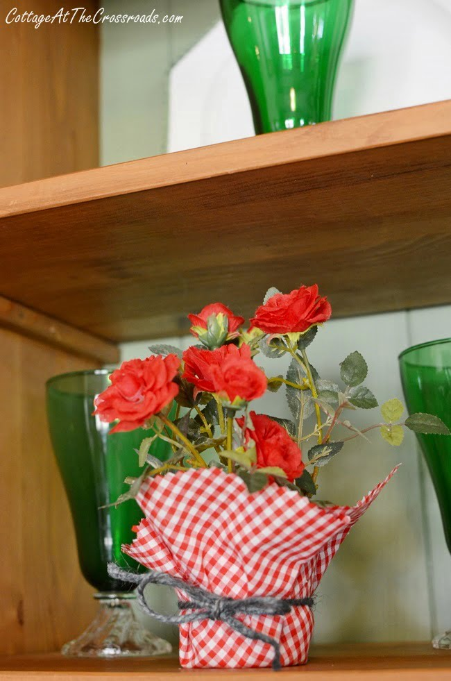 red gingham wrapped faux rose plant