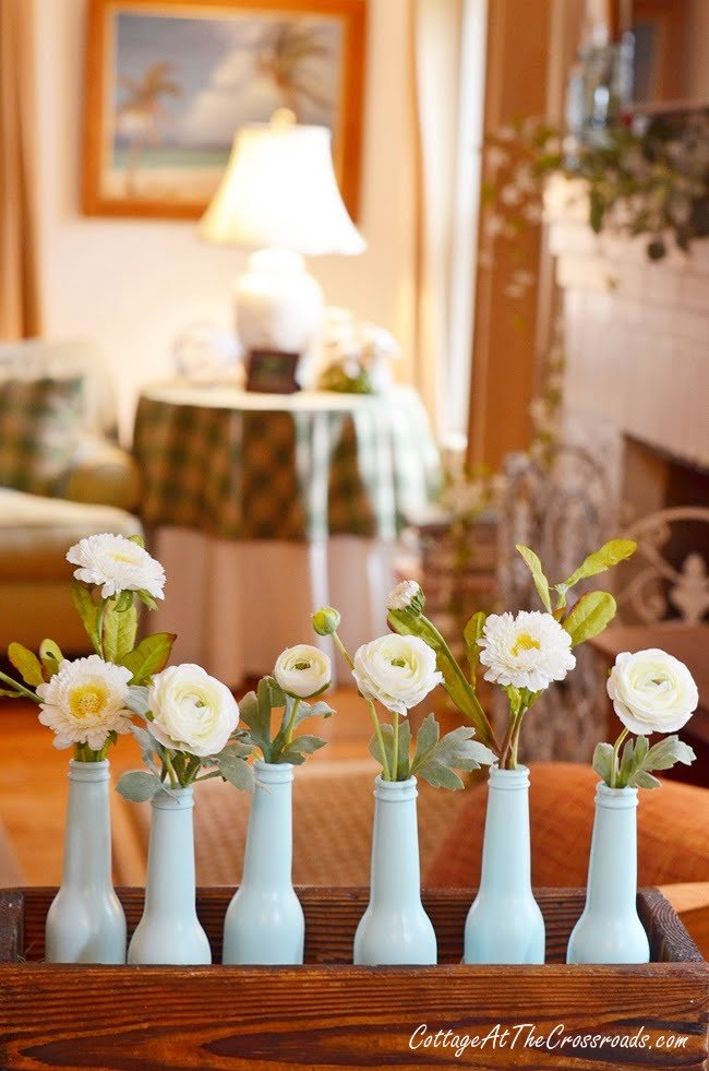 aqua painted bottle spring centerpiece