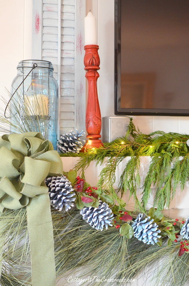 blue wooden shutters on a Christmas mantel