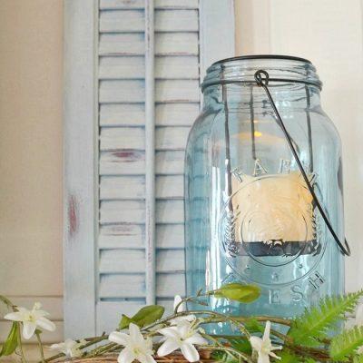 Blue wooden shutter with a blue Mason jar