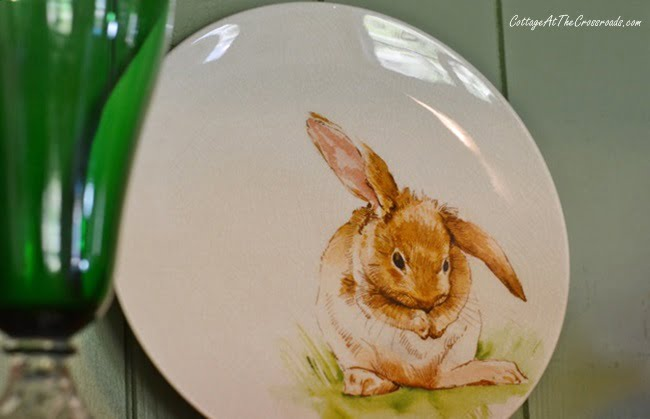 bunny plates displayed in a pine cupboard on a spring tour