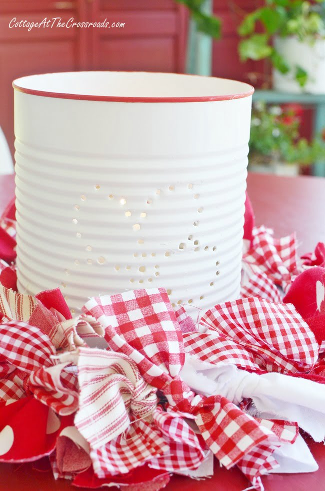 Punched tin can lanterns