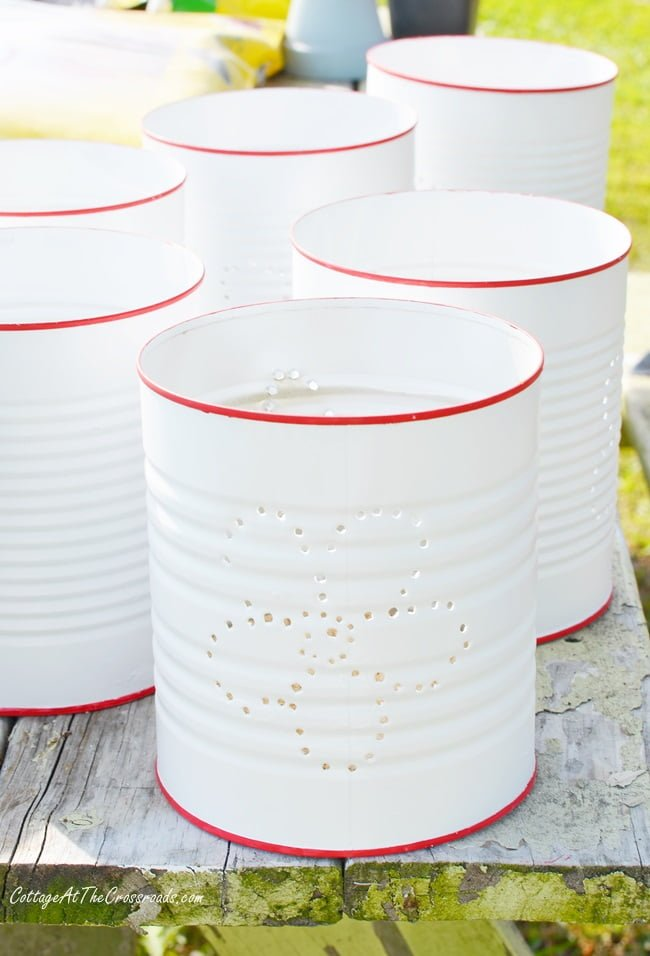 painted punched tin can lanterns