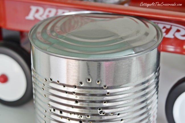 bulging bottom of punched tin can
