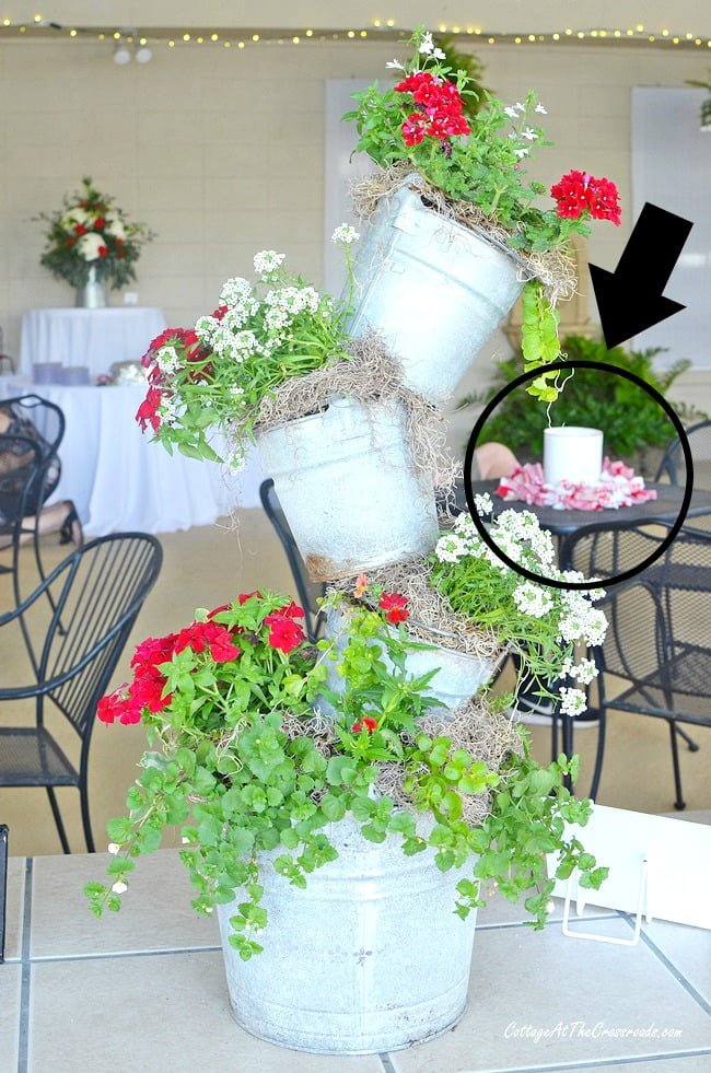 Punched tin can lanterns used as centerpieces at a party
