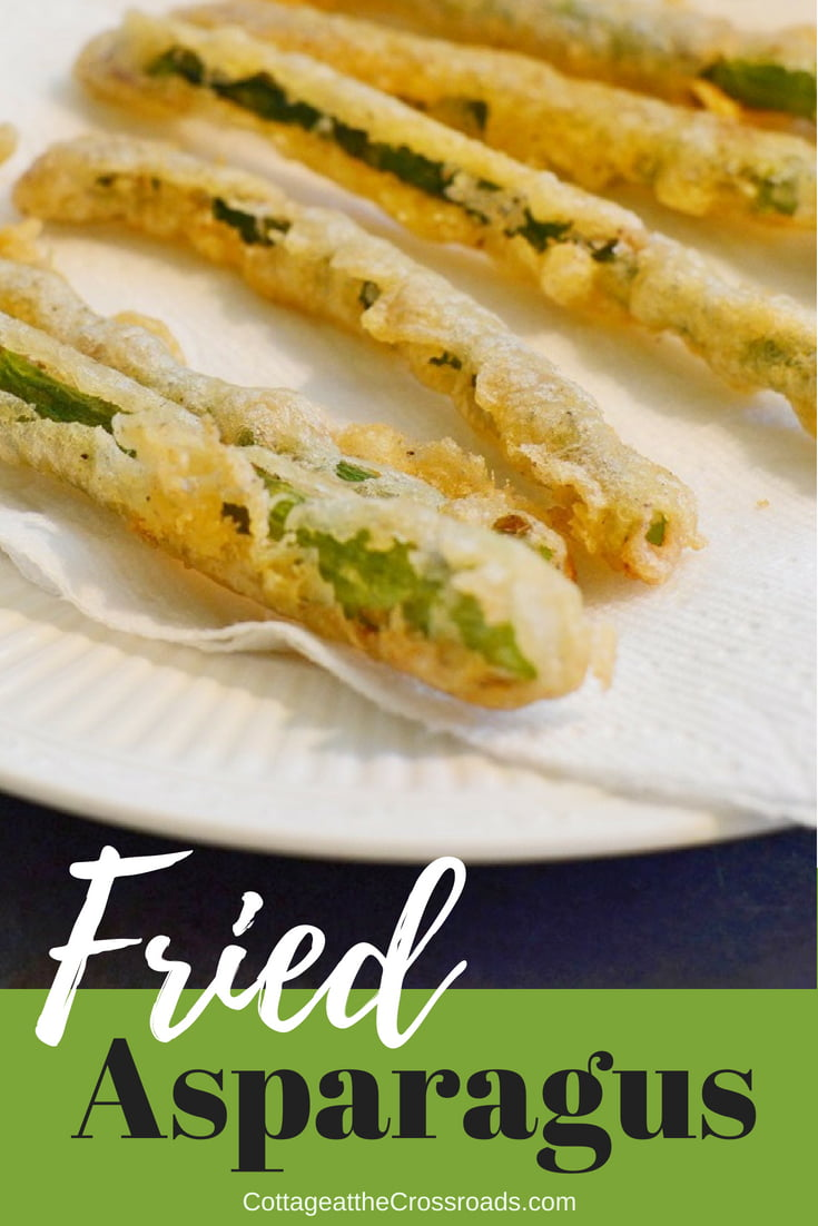 This beer battered fried asparagus with a spicy dipping sauce will disappear fast.  You can easily recreate this restaurant favorite at home. #friedasparagus  #beerbatter