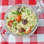 orzo salad in a glass container