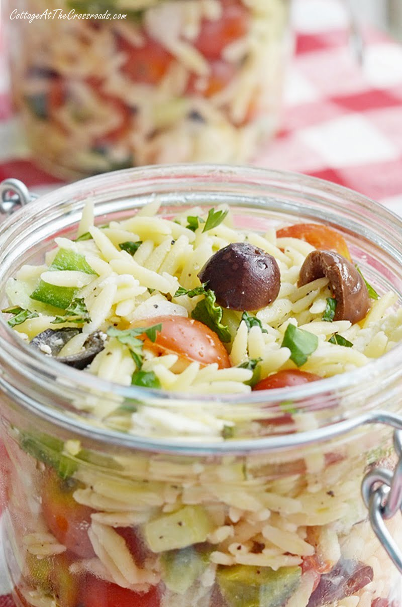 lemony orzo salad in glass containers