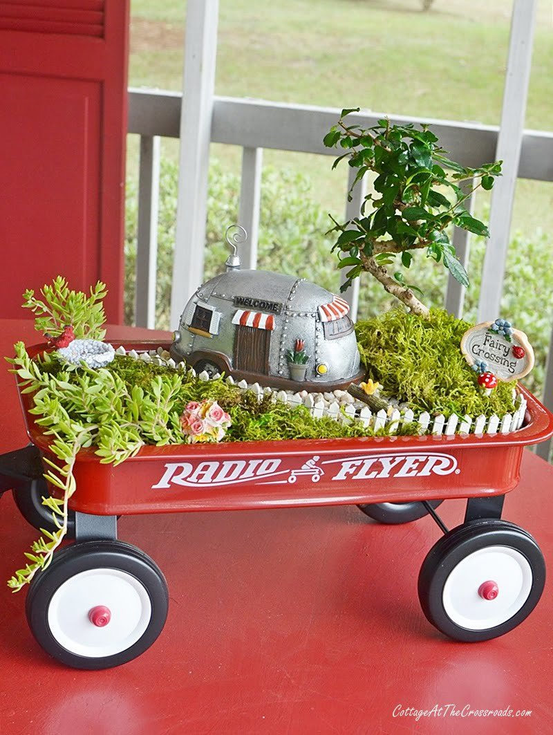 Fairy Garden In A Red Wagon With A Camping Theme